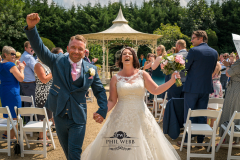 bride and groom celebrating walking down the aisle