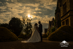 bride and groom at sunset at manor by the lake