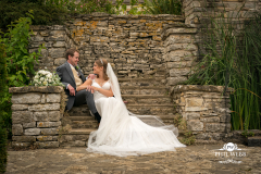 bride and groom sat on steps at Glenfall House