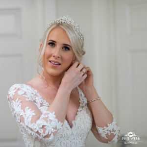 bride adjusting her ear ring