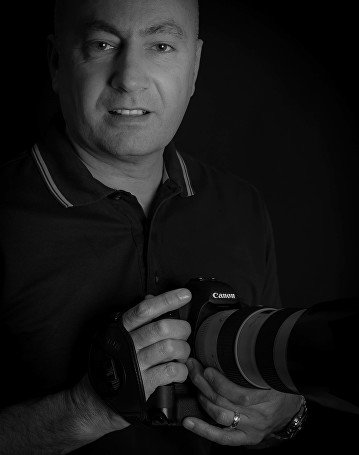Black and white picture photographer holding a camera