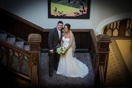 wedding pictures tortworth court bride and groom staircase