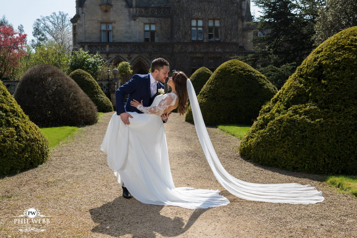 manor by the lake wedding pictures bride groom yew trees kissing