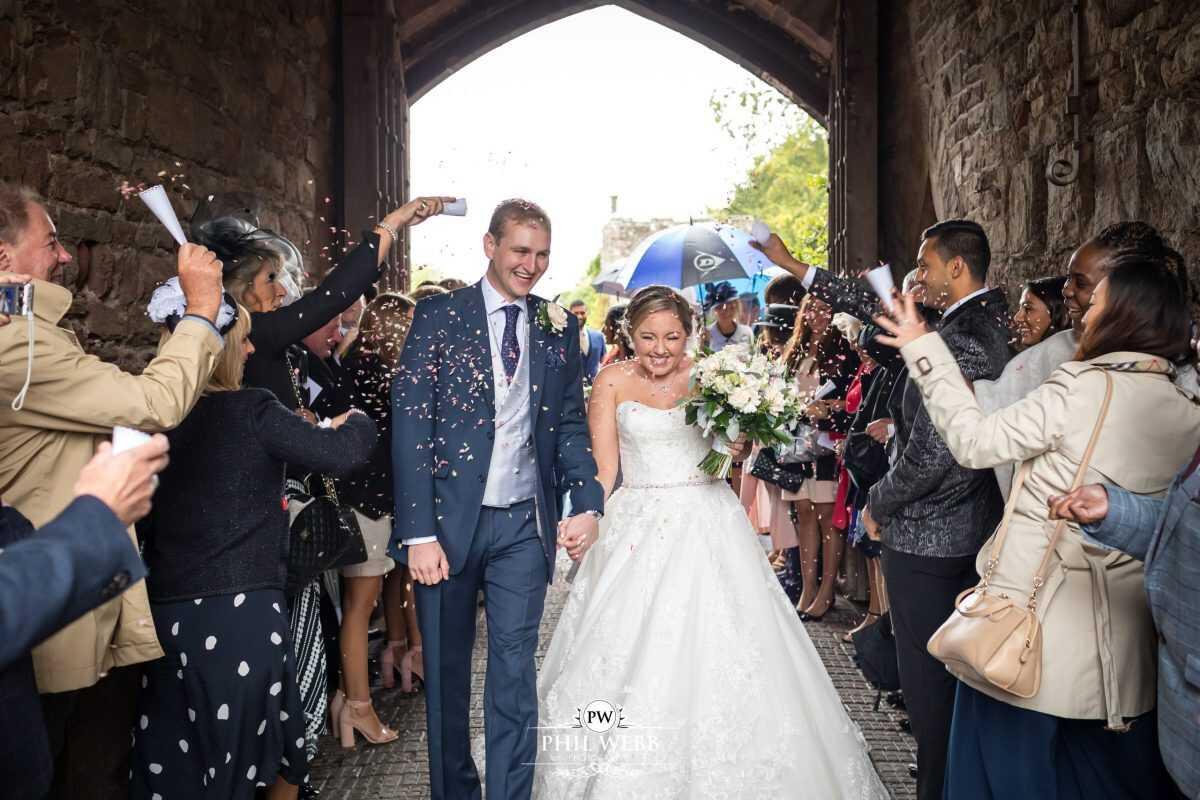 Berkley Castle wedding bride groom confetti