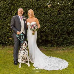 bride and groom with their dog Dalmatian