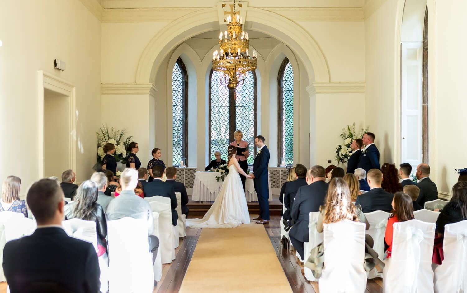 bride and groom during wedding ceremony at clearwell castle