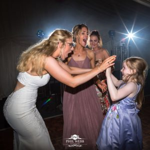 Bride and bridesmaid dancing at Bordesley Park Farm