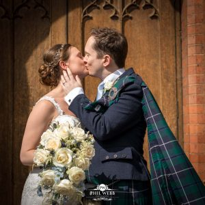bride and groom kissing outside dean close chapel